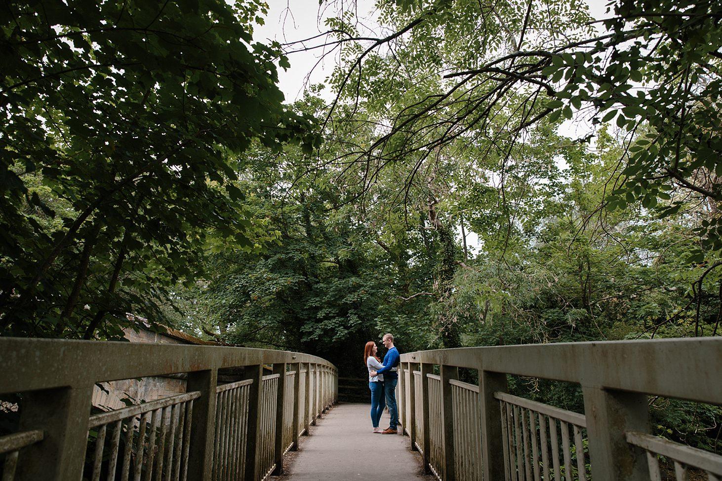 arundel engagement shoot couple on bridge
