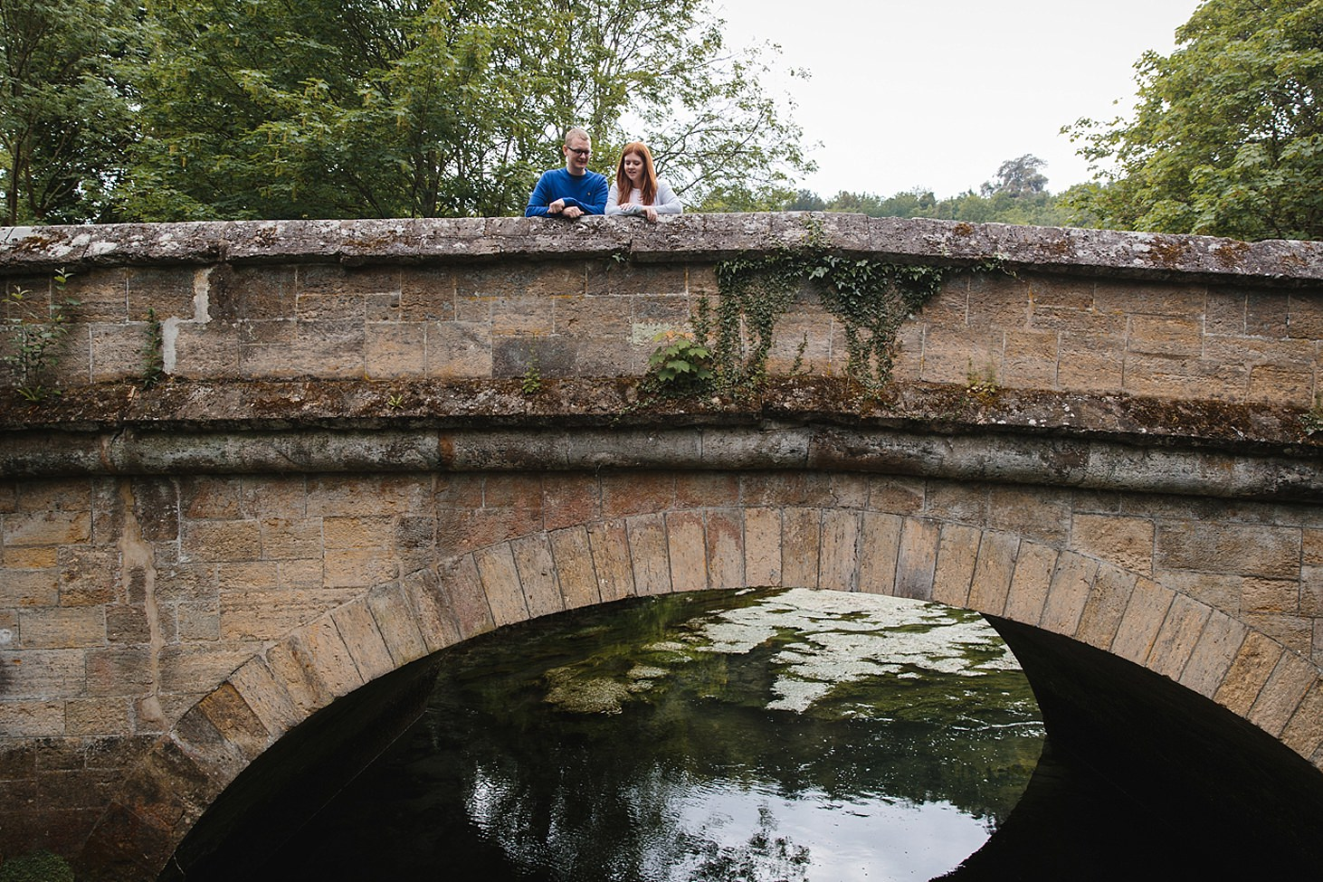 arundel engagement shoot couple on bridge over river