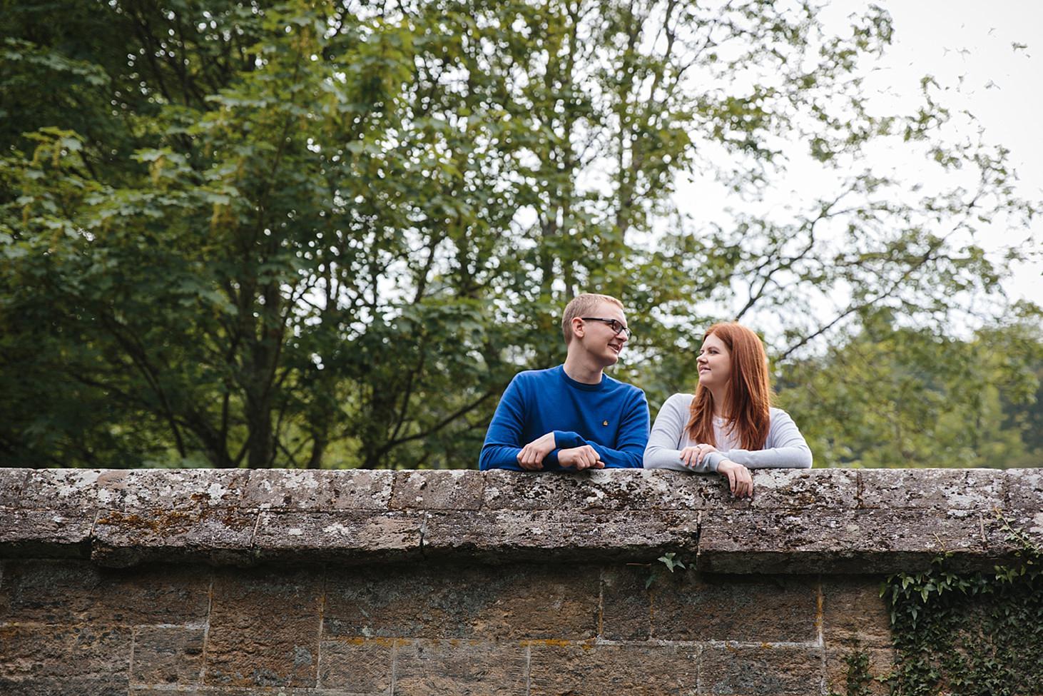 arundel engagement shoot couple chatting on bridge