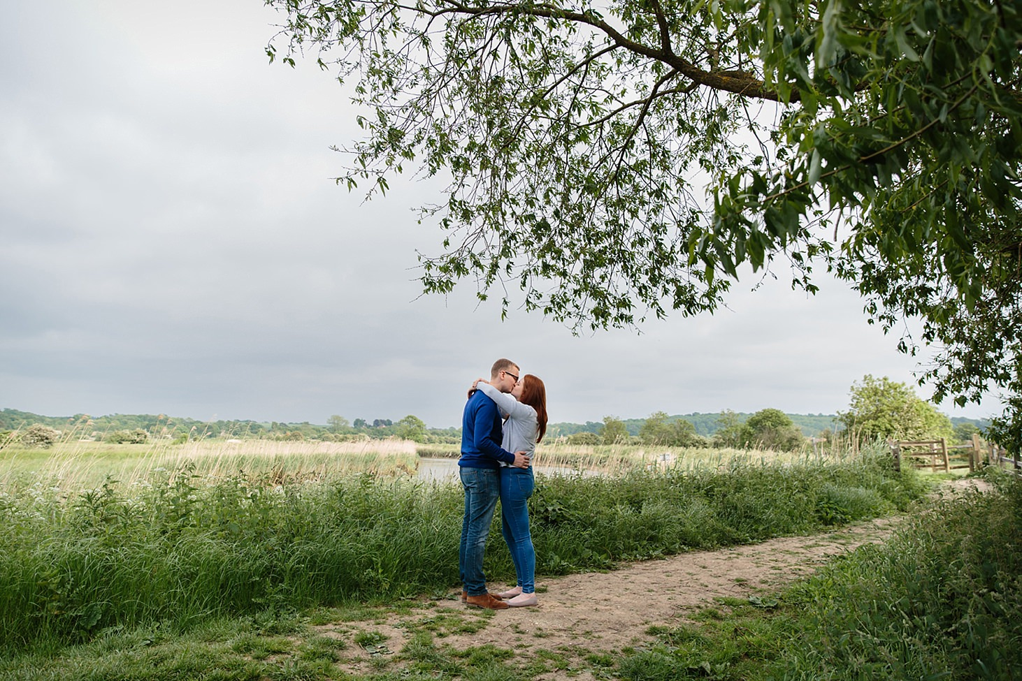 arundel engagement shoot couple kiss by river