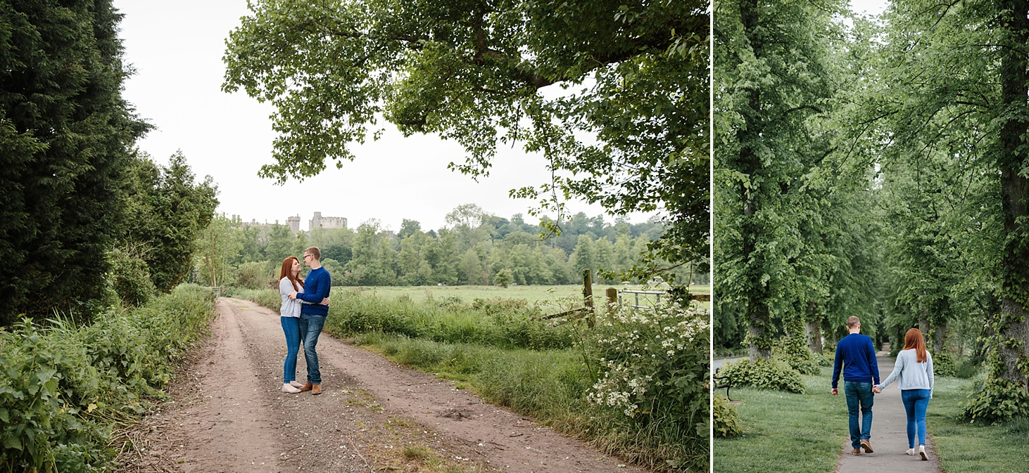arundel engagement shoot couple walking with tall trees
