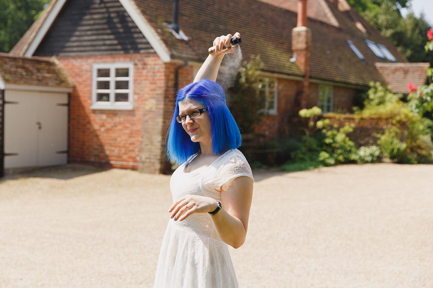 gate street barn wedding photography bride with hairspray