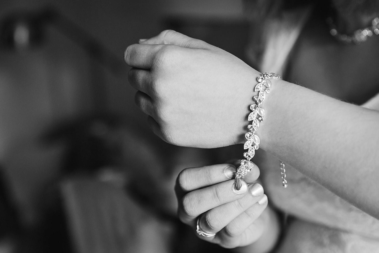 gate street barn wedding photography bride doing up bracelet
