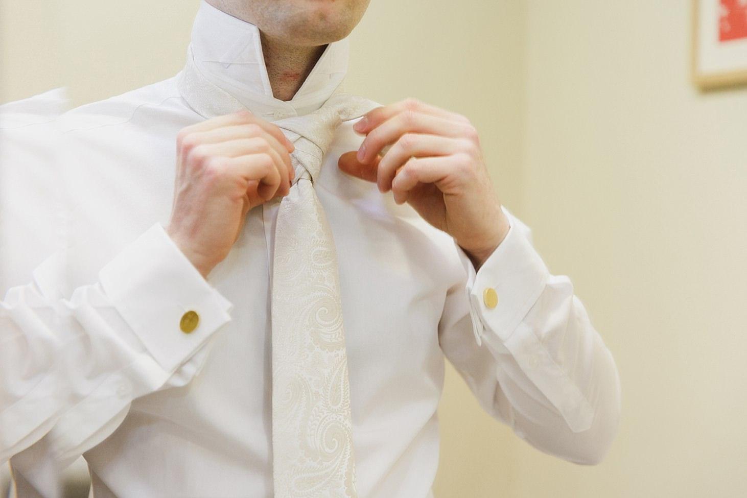 gate street barn wedding photography groom doing tie