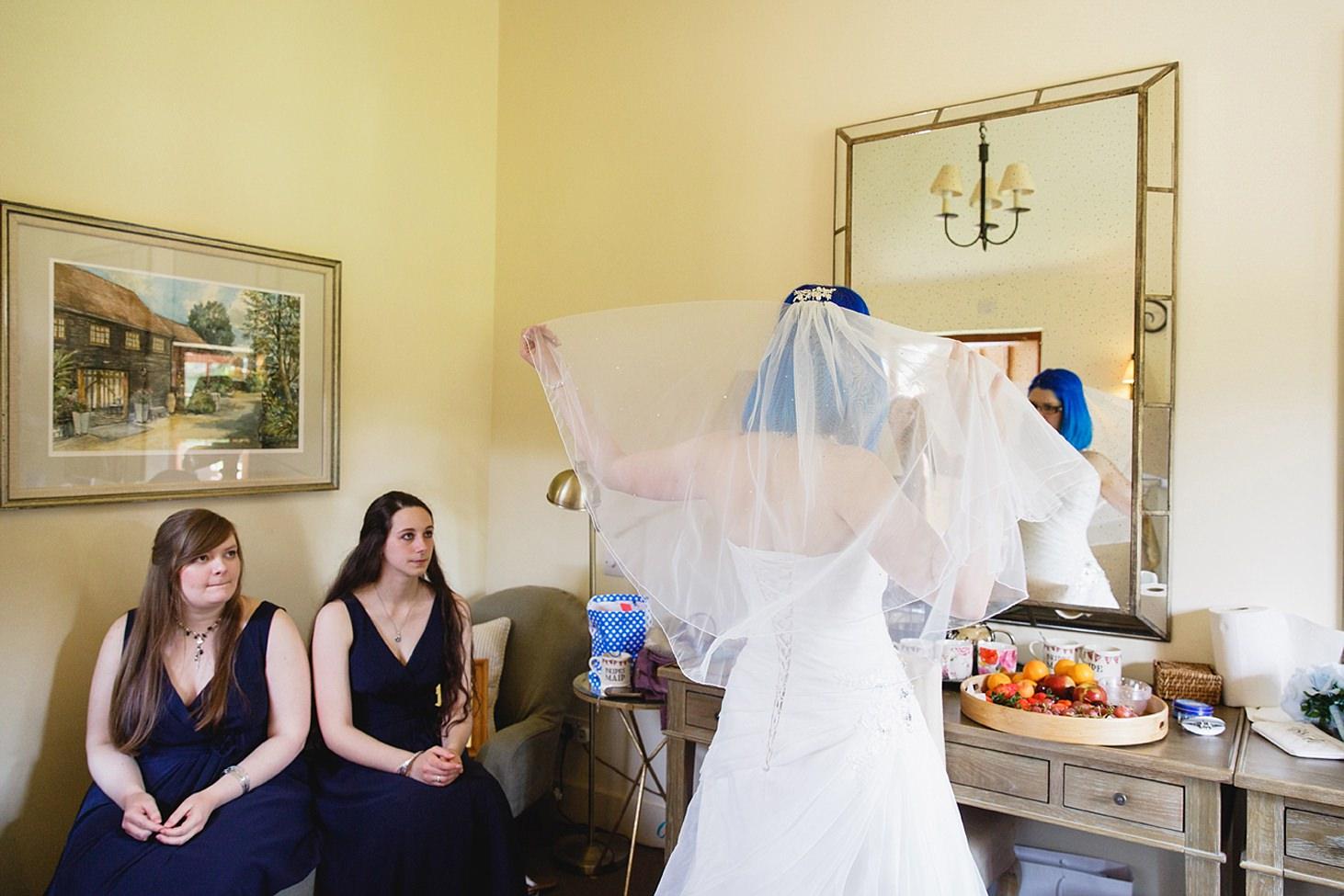 gate street barn wedding photography bride putting on veil