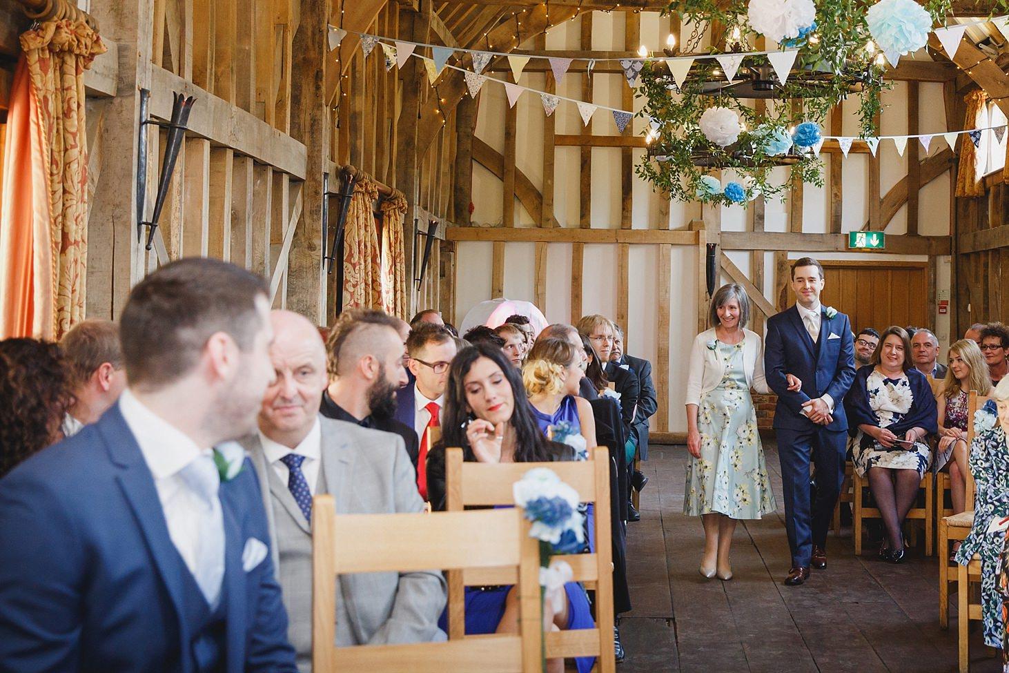 gate street barn wedding photography groom walking down aisle