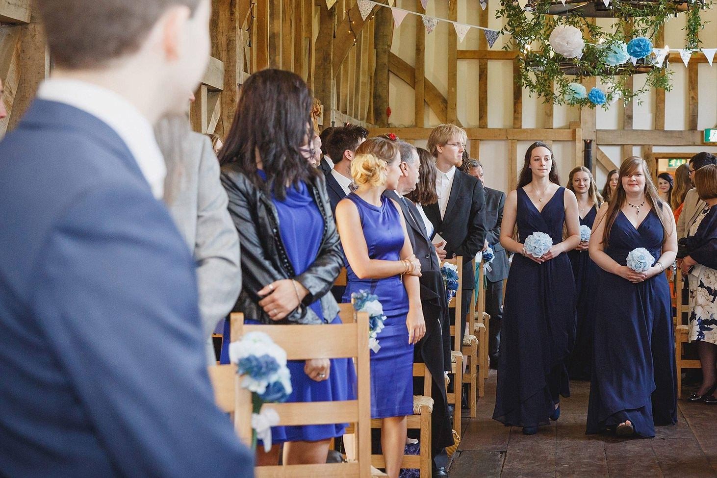 gate street barn wedding photography bridesmaids walking down aisle