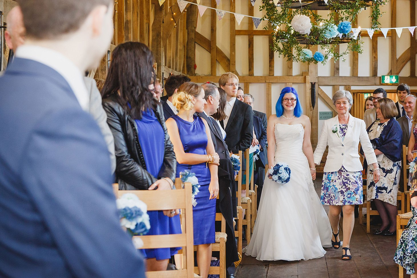 gate street barn wedding photography bride walking down aisle with her mum