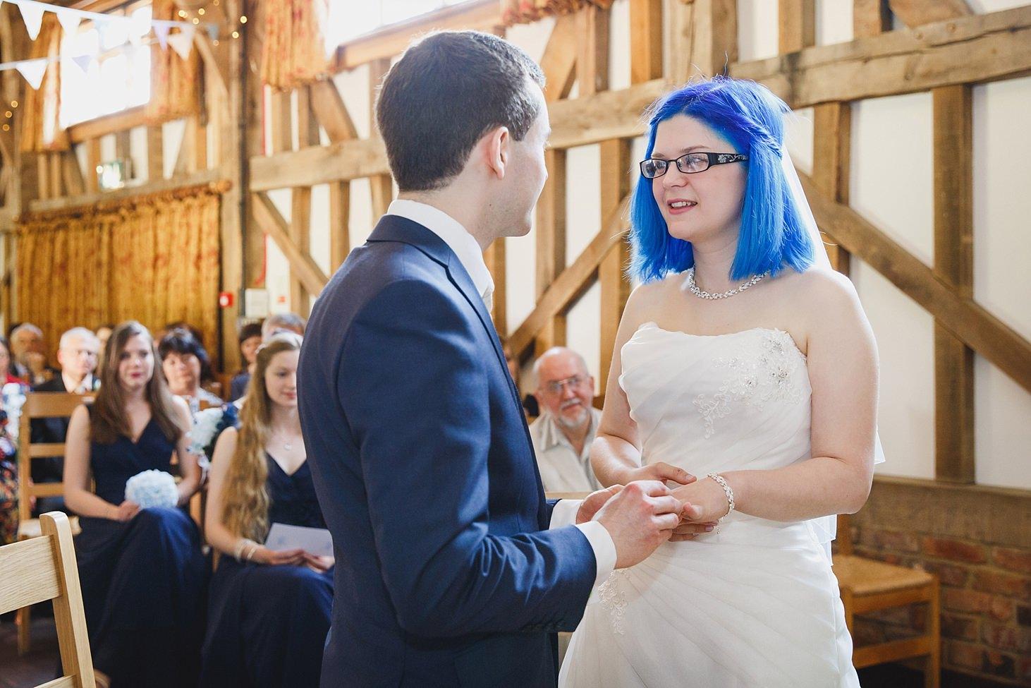 gate street barn wedding photography bride and groom exchange rings