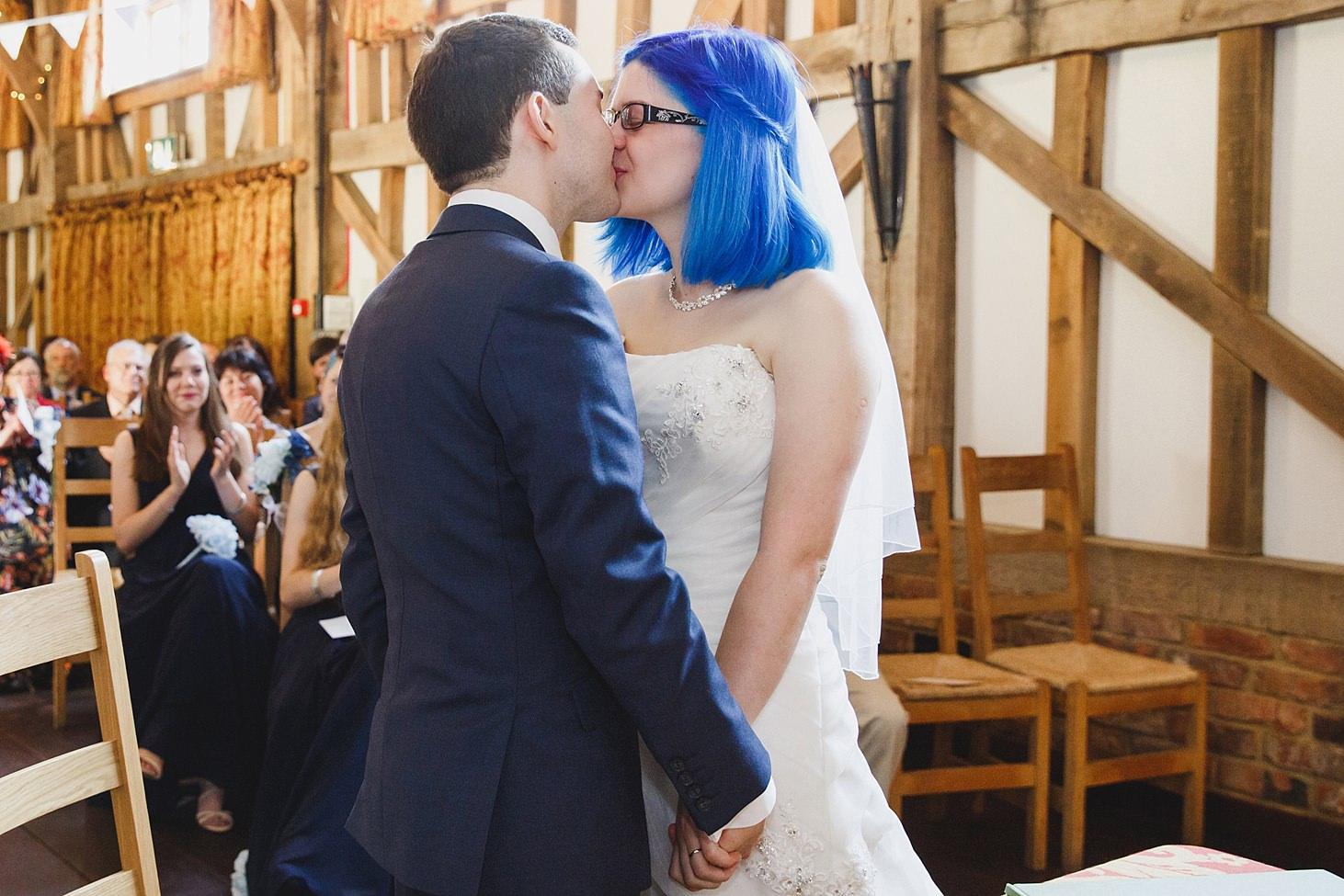 gate street barn wedding photography bride and groom first kiss
