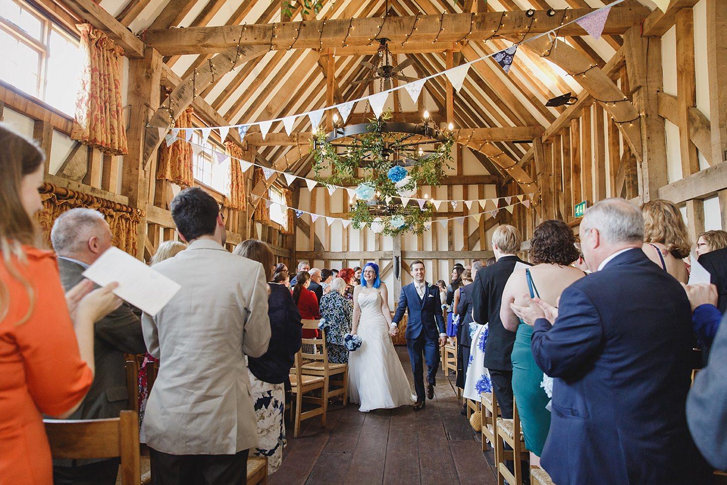 gate street barn wedding photography bride and groom walk down aisle