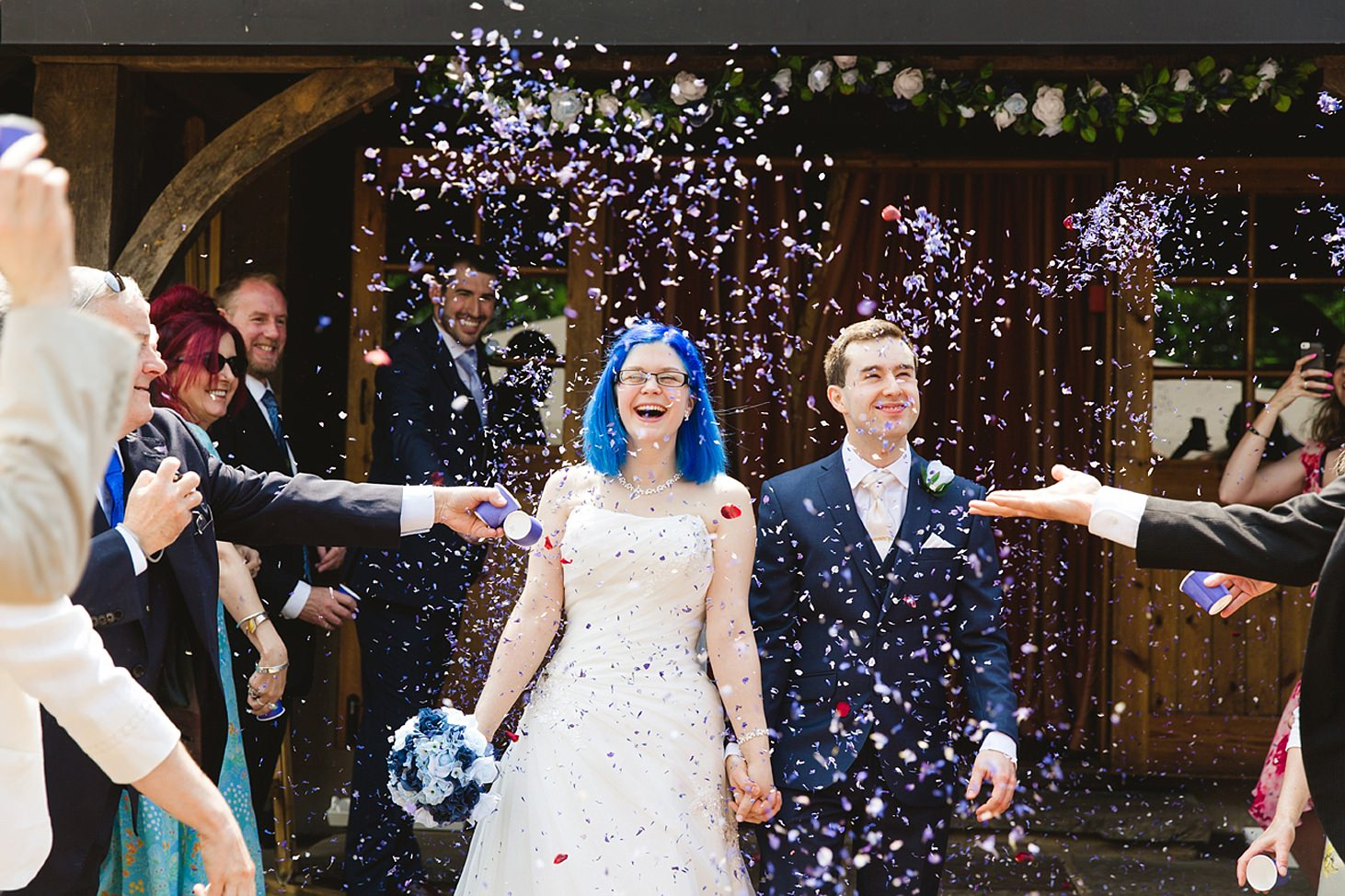 gate street barn wedding photography bride and groom in confetti