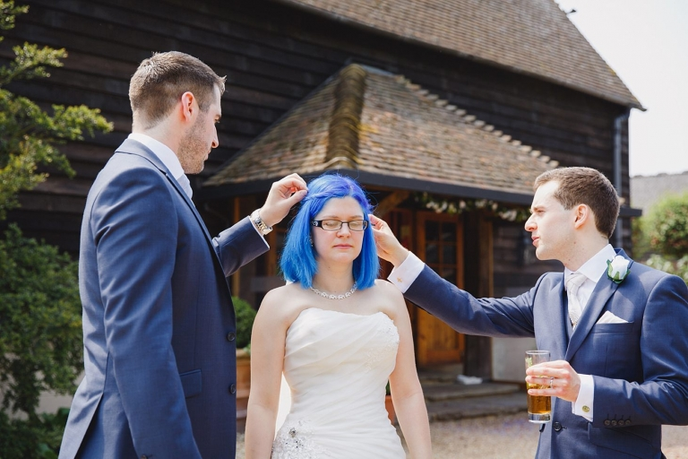 gate street barn wedding photography pulling confetti out of hair