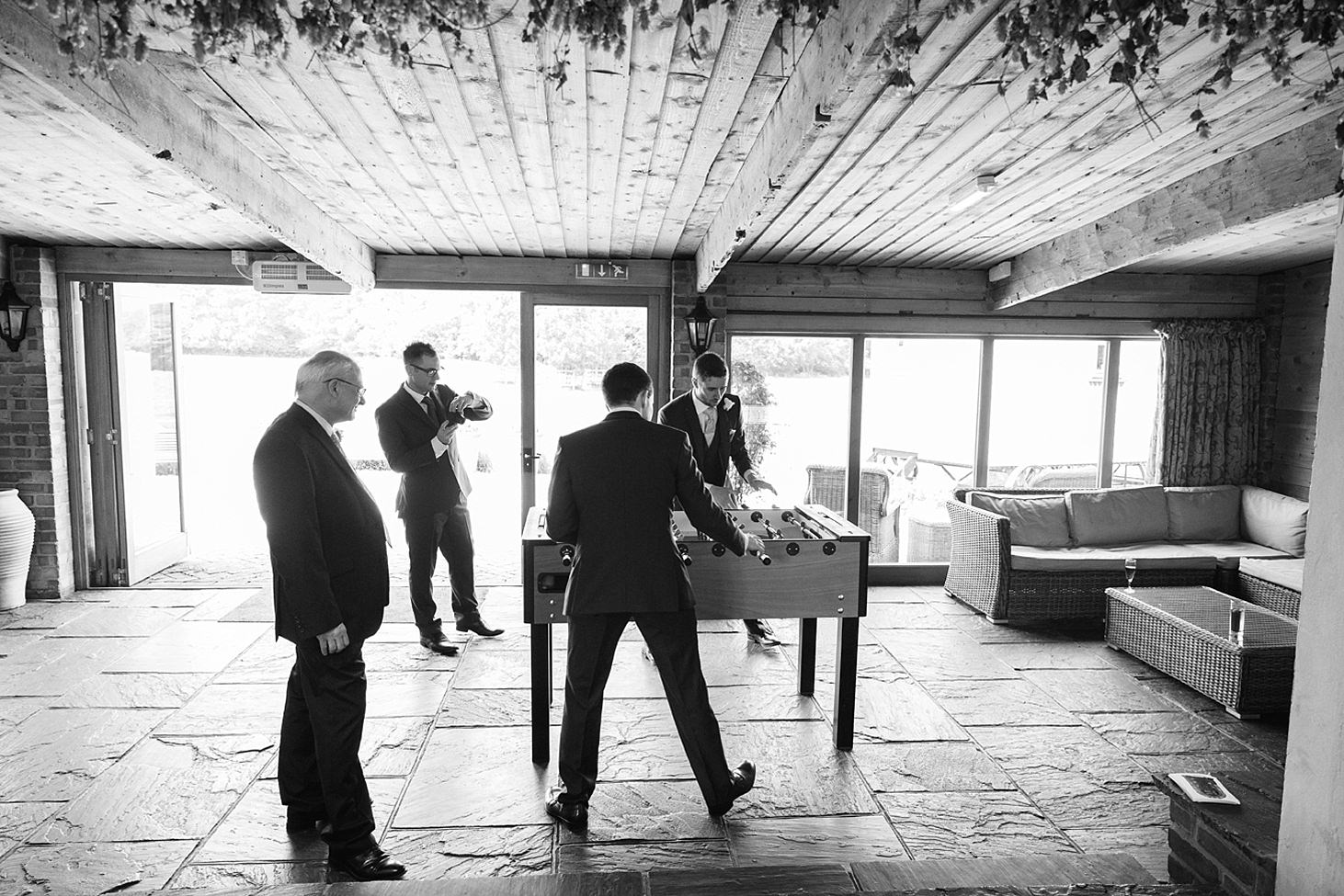 gate street barn wedding photography guests and table football