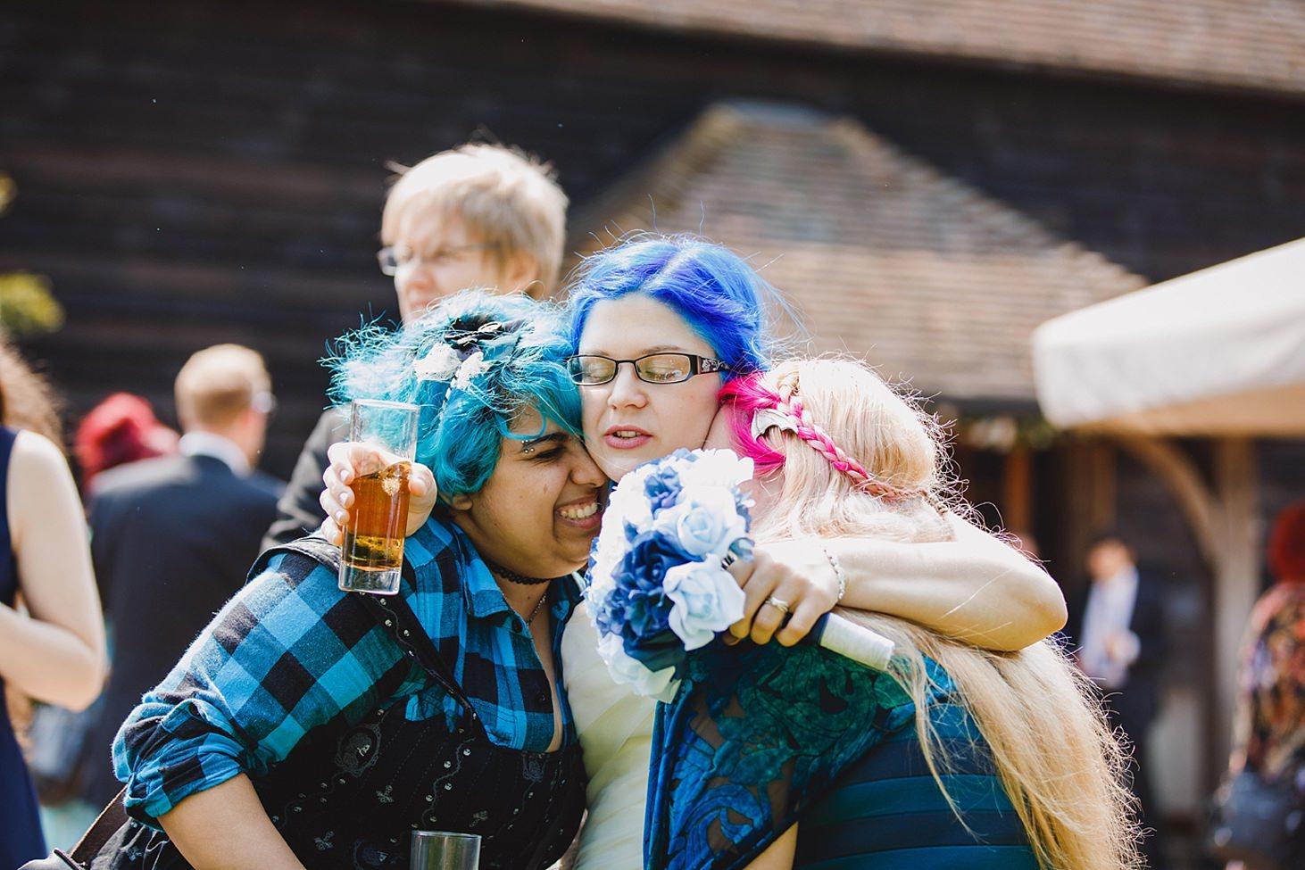 gate street barn wedding photography bride hugging guests