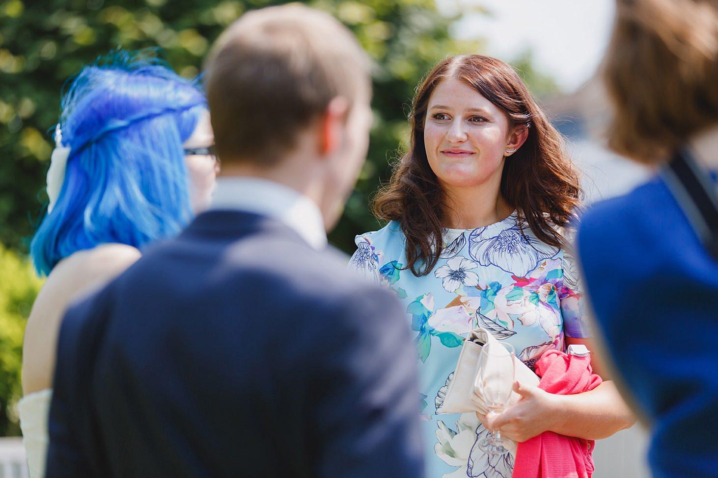 gate street barn wedding photography wedding guests chatting