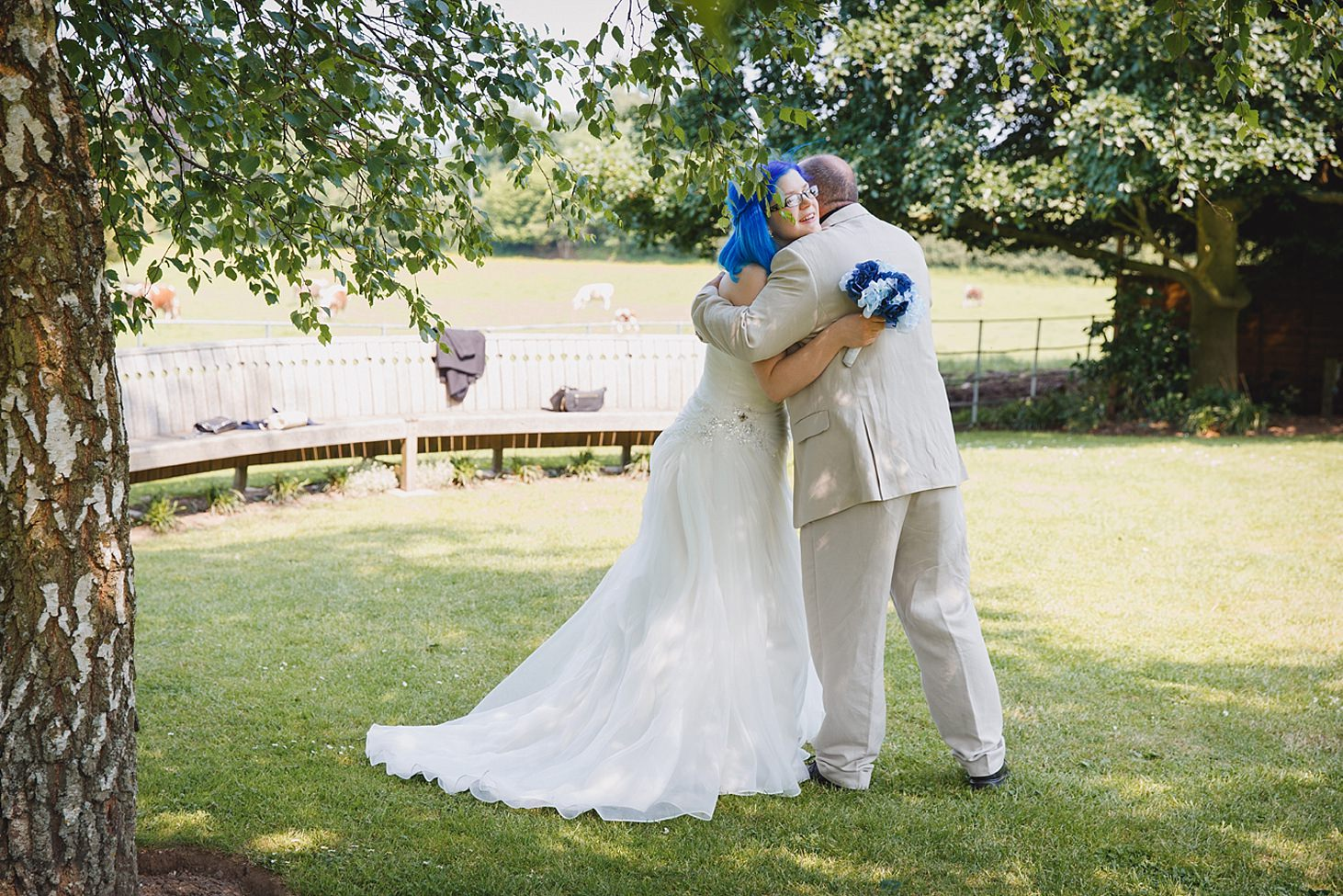 gate street barn wedding photography guest hugging bride