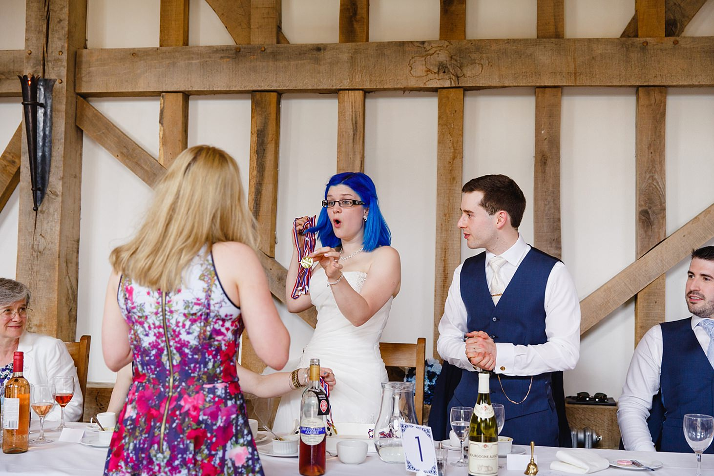 gate street barn wedding photography bride with medal