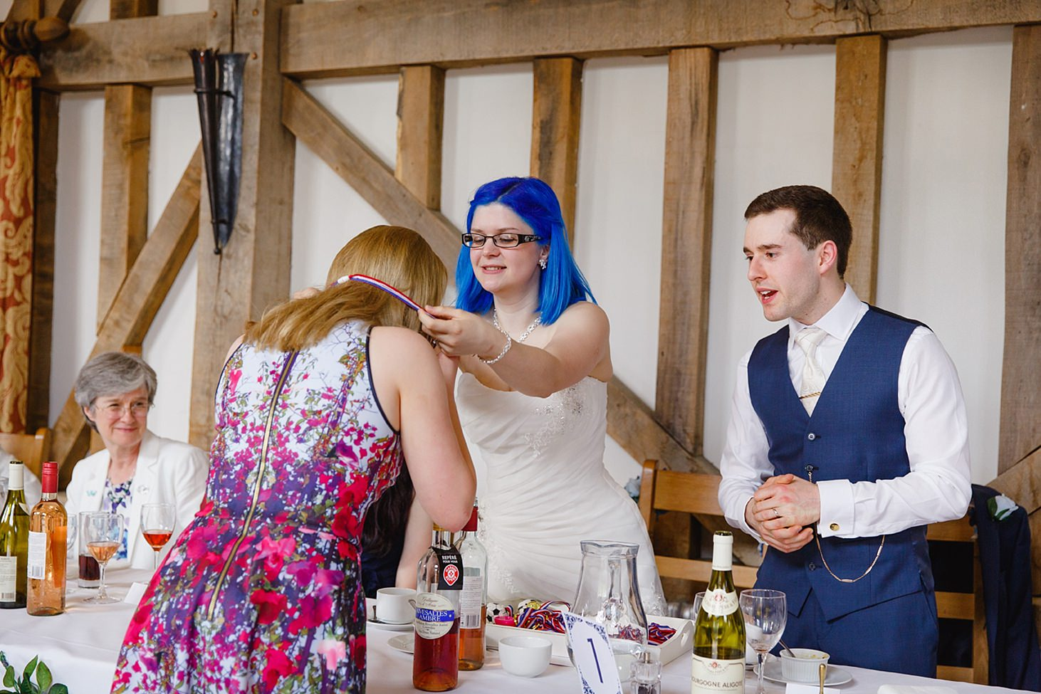 gate street barn wedding photography bride giving medal
