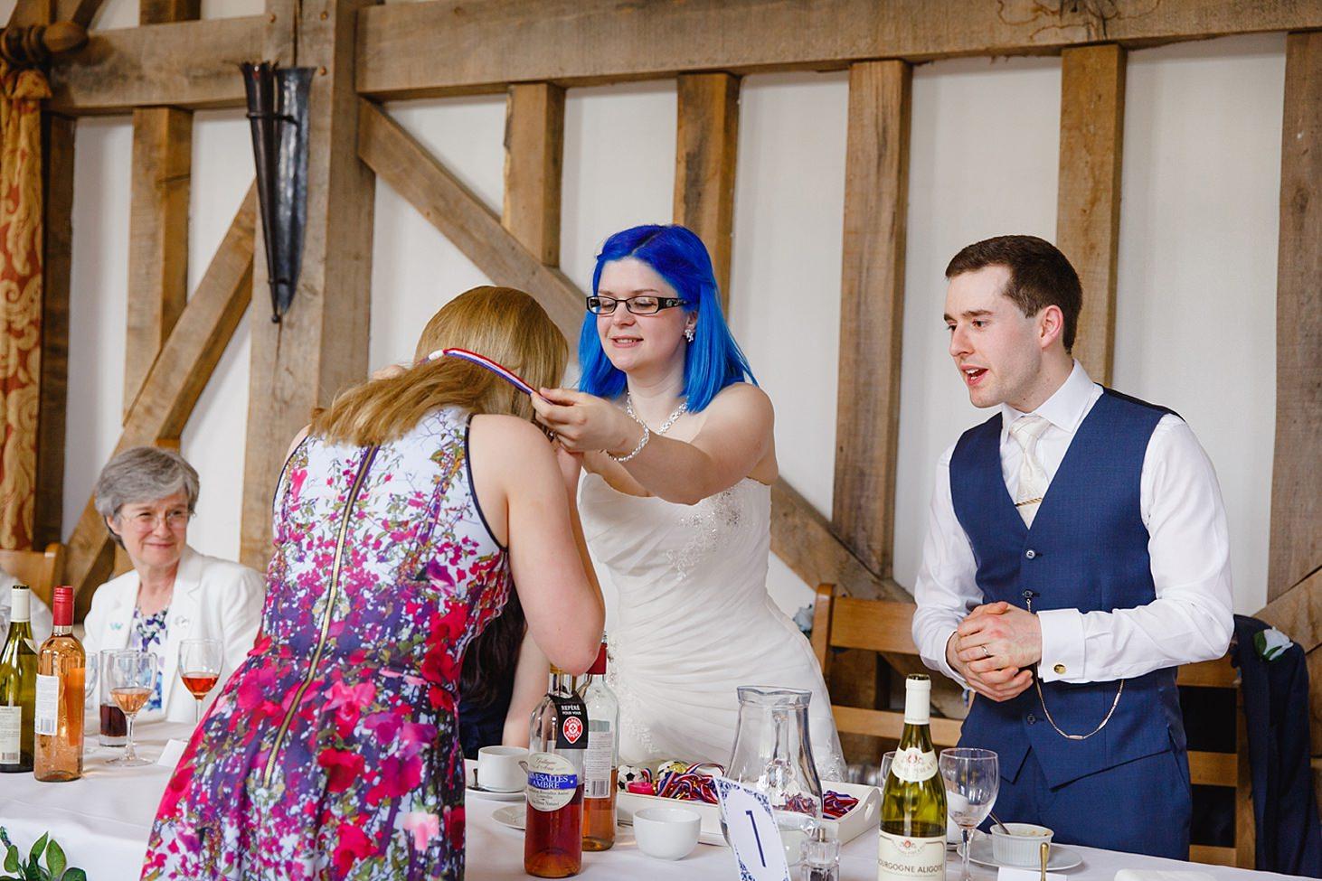 gate street barn wedding photography bride giving medal