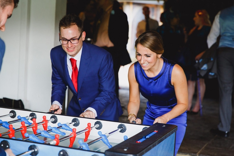 gate street barn wedding photography guests playing table football