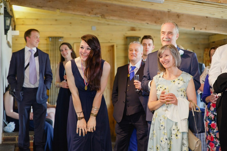 gate street barn wedding photography guests laughing