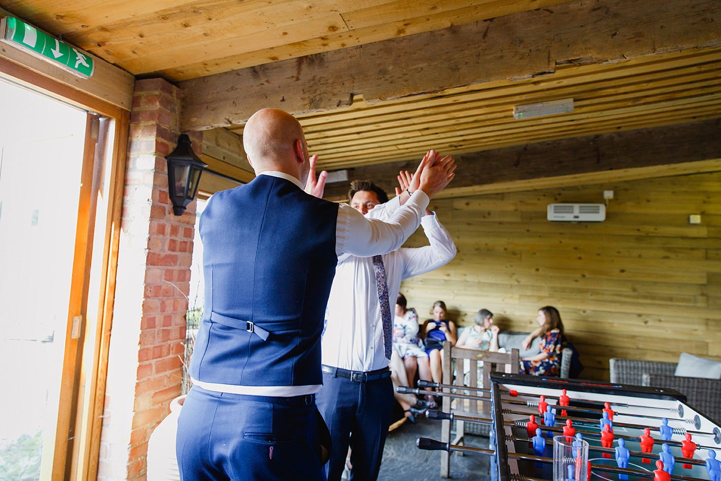 gate street barn wedding photography guests high five