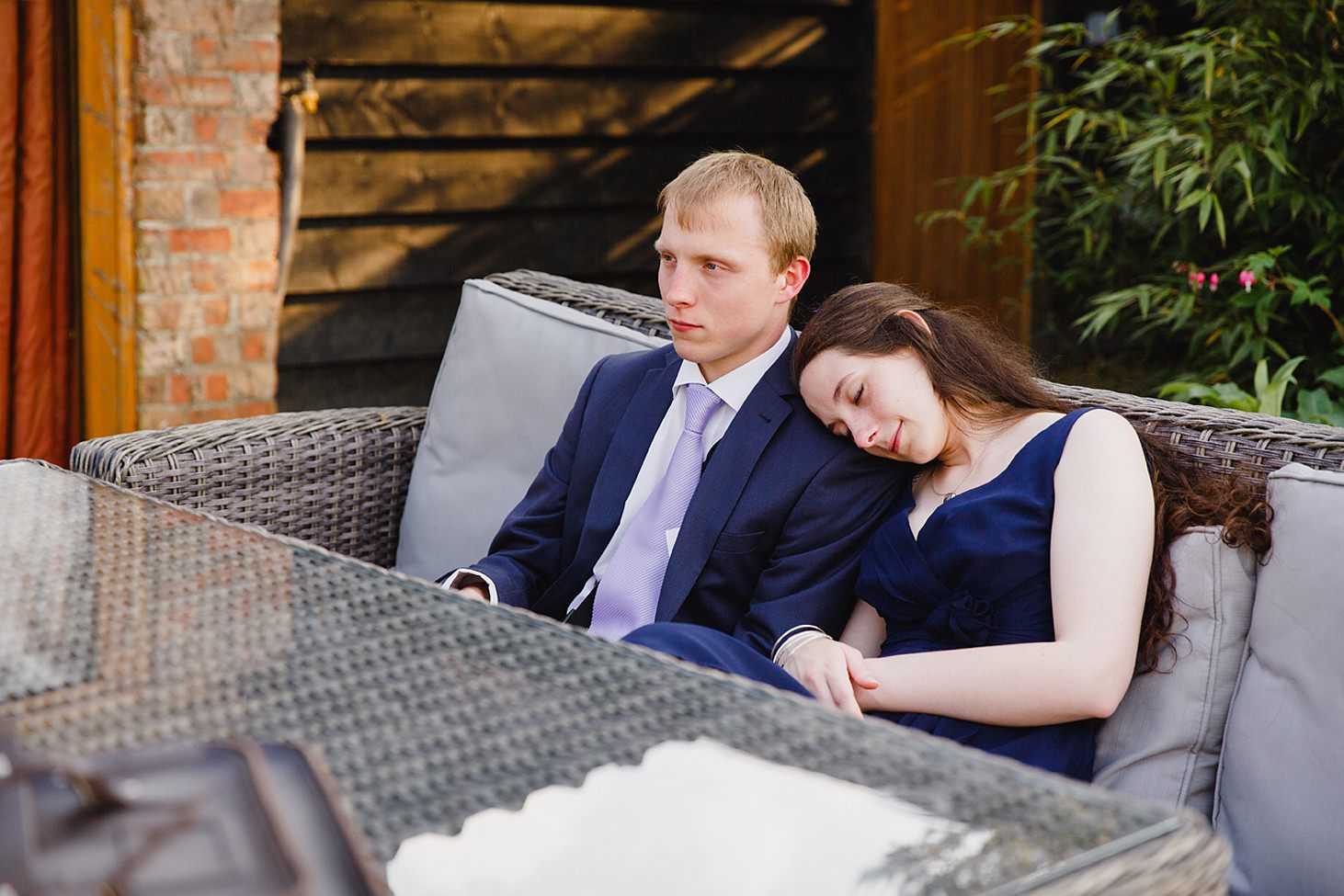 gate street barn wedding photography bridesmaid dozing