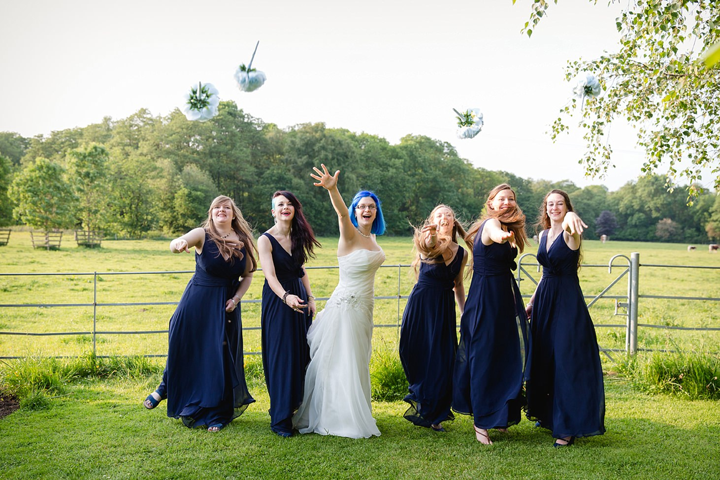 gate street barn wedding photography throwing bouquets