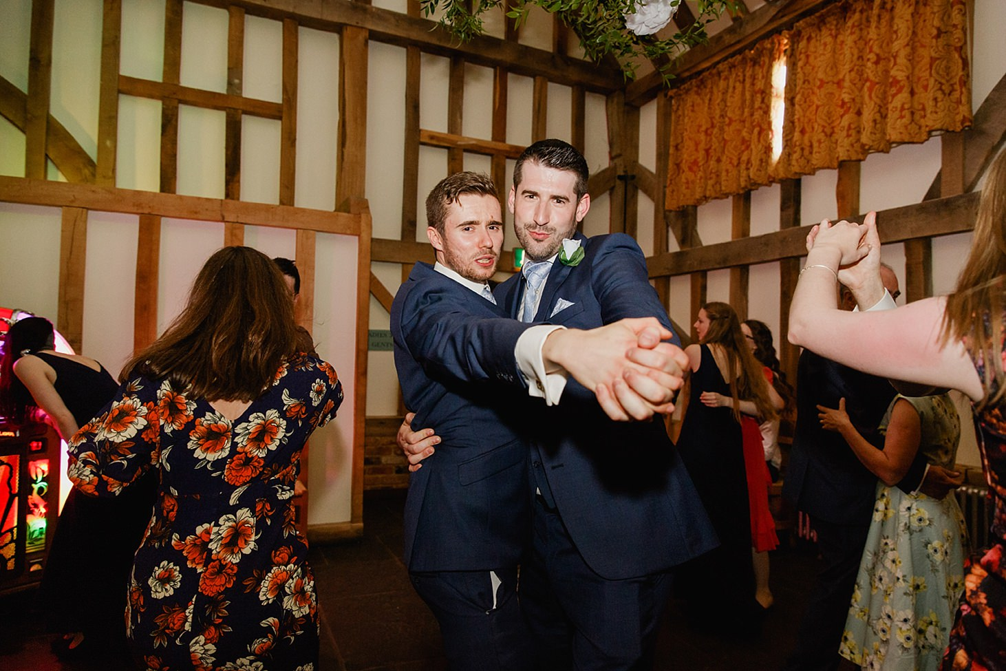 gate street barn wedding photography groomsmen dancing