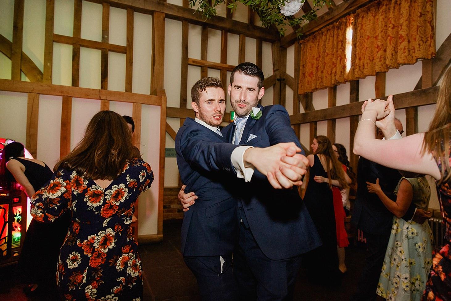 gate street barn wedding photography groomsmen dancing