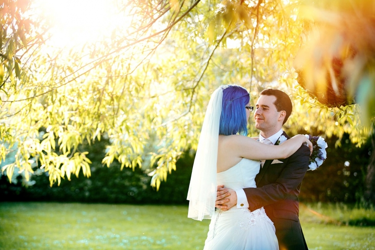 gate street barn wedding photography bride and groom together under tree