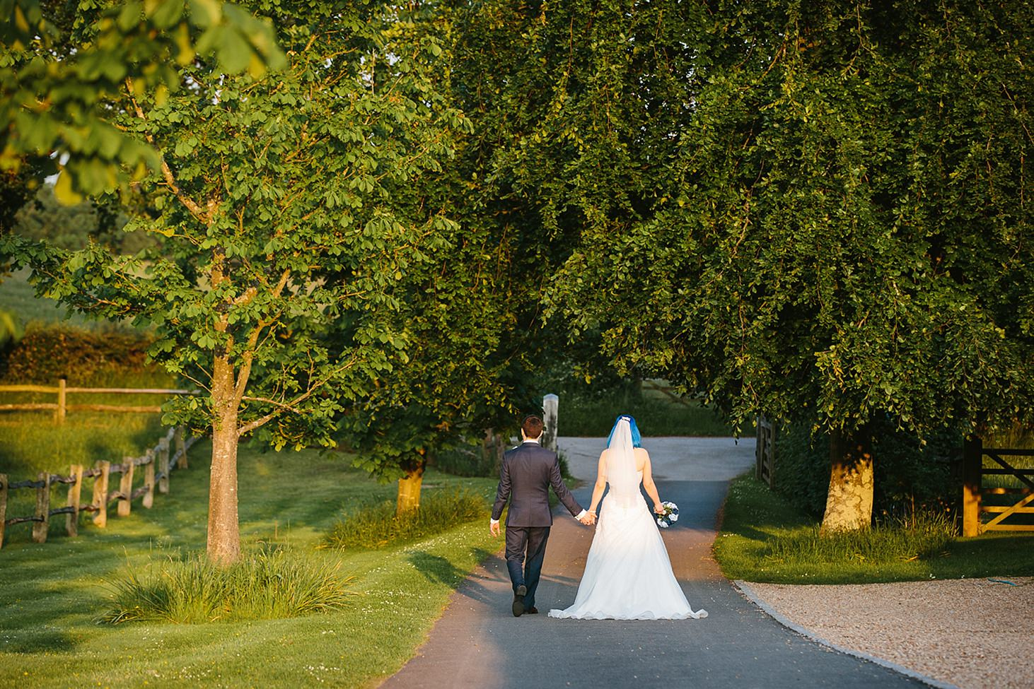 gate street barn wedding photography bride and groom walking
