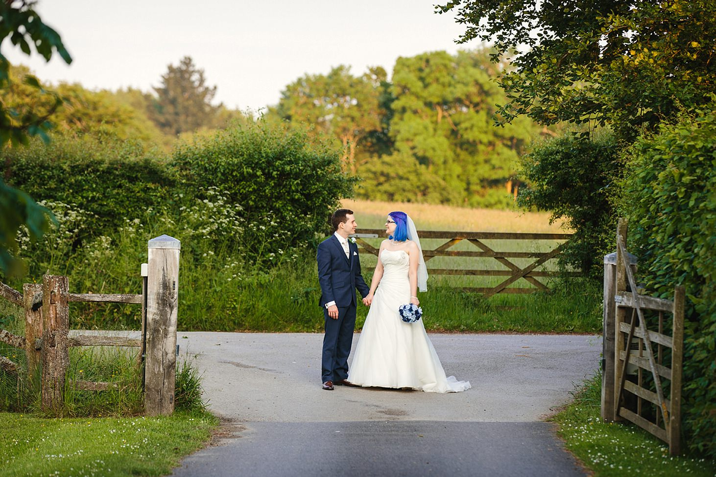 gate street barn wedding photography bride and groom by gate