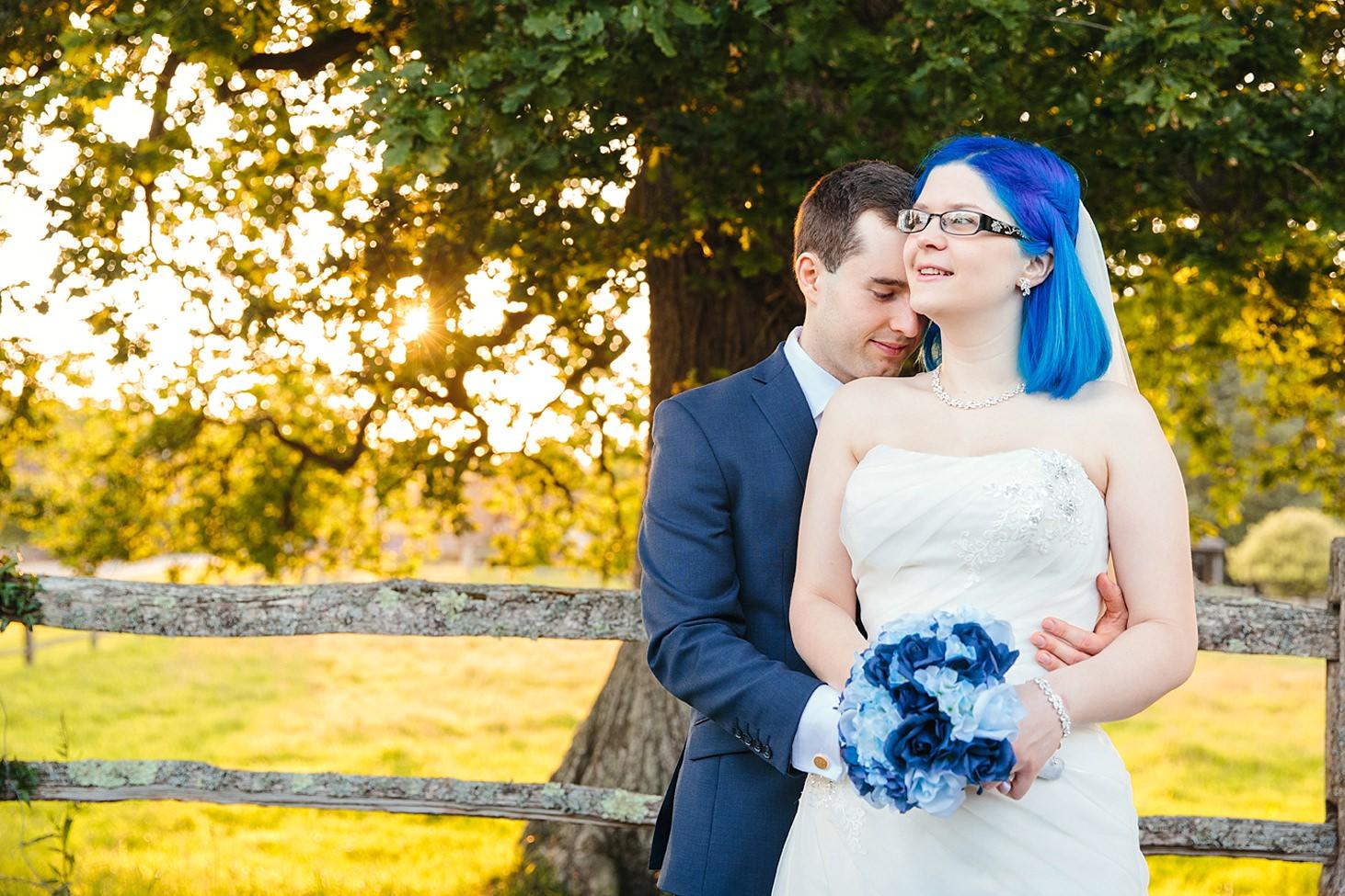 gate street barn wedding photography groom hugging bride