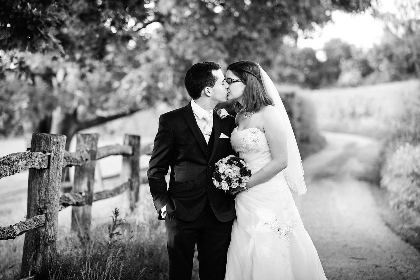 gate street barn wedding photography groom and bride kiss