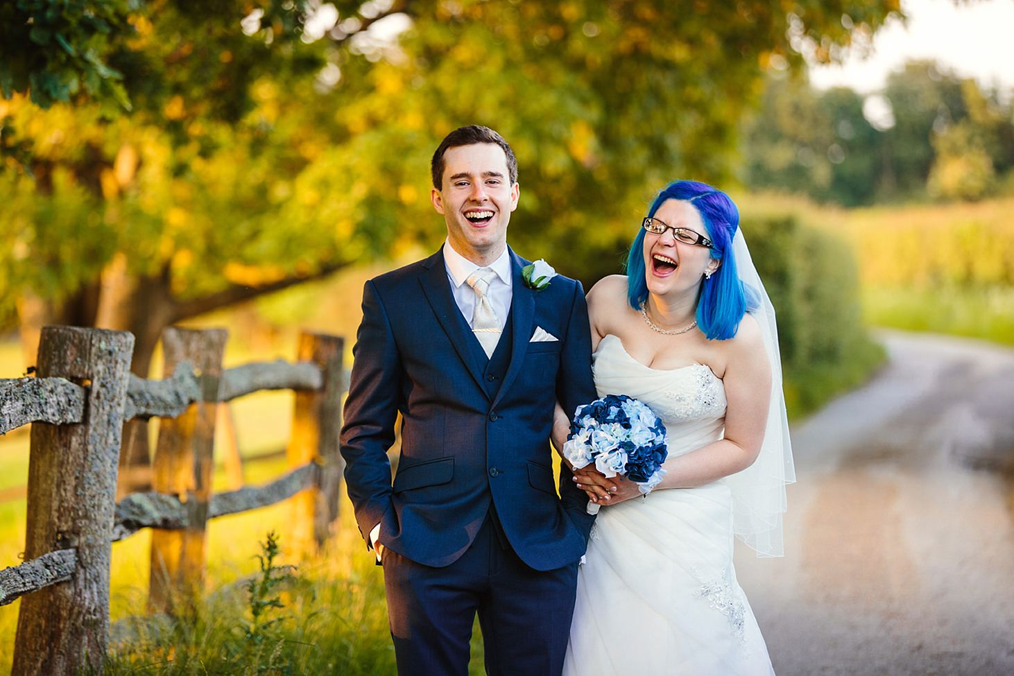 gate street barn wedding photography bride and groom laughing