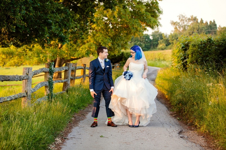 gate street barn wedding photography bride and groom showing shoes