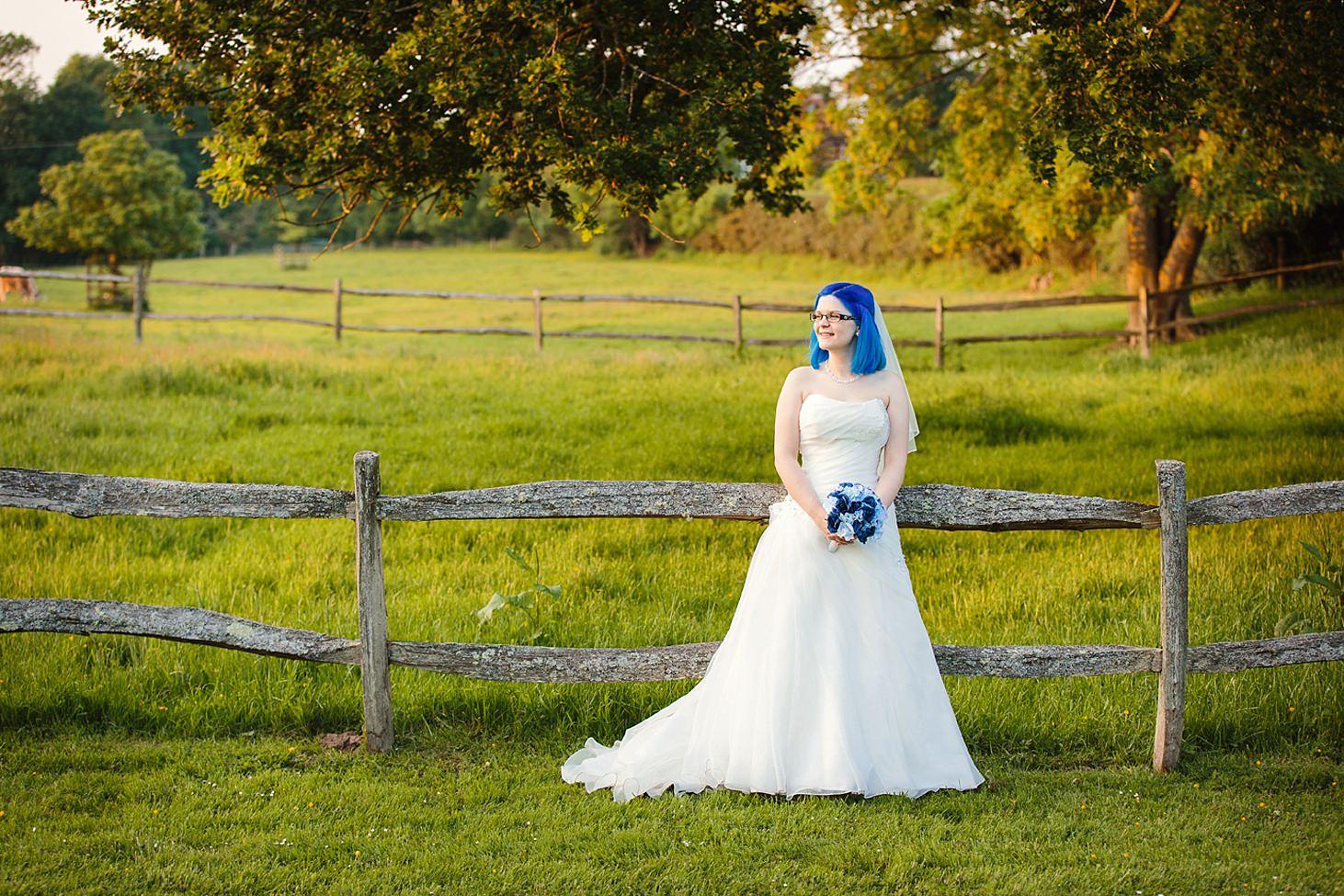 gate street barn wedding photography bride by fence