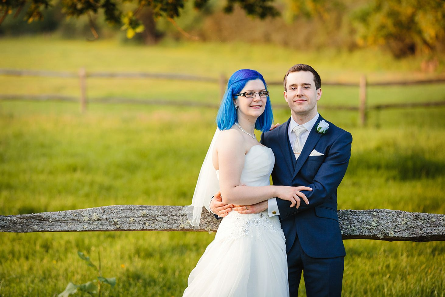 gate street barn wedding photography bride and groom together by fence