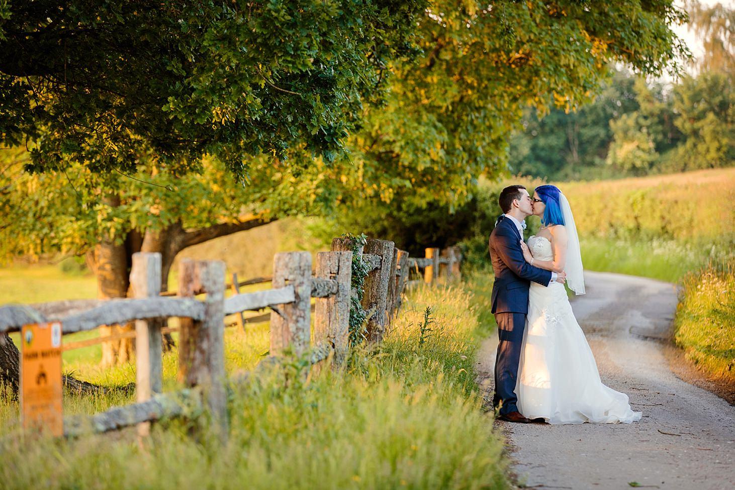 gate street barn wedding photography bride and groom kiss on pathway