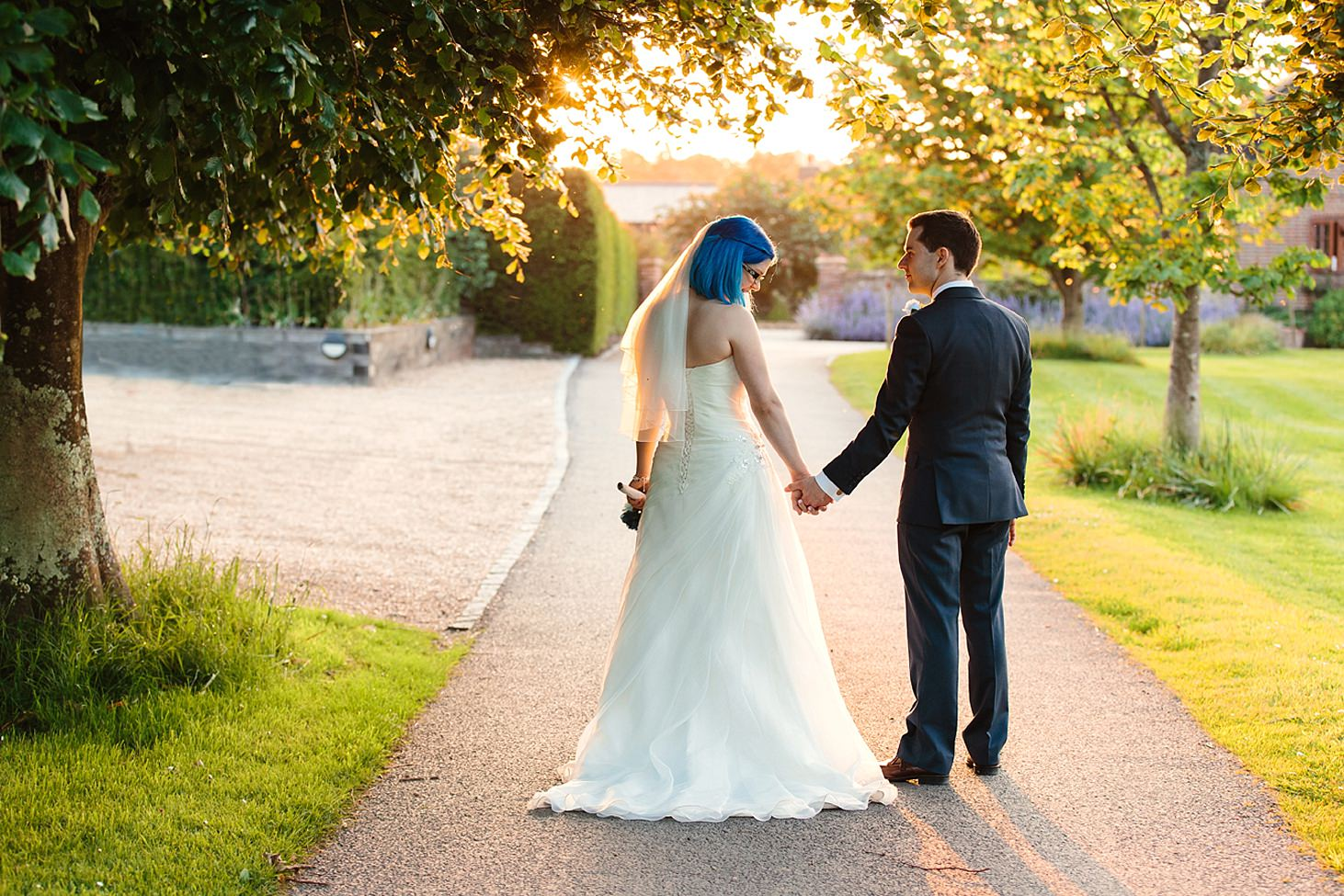gate street barn wedding photography bride and groom holding hands