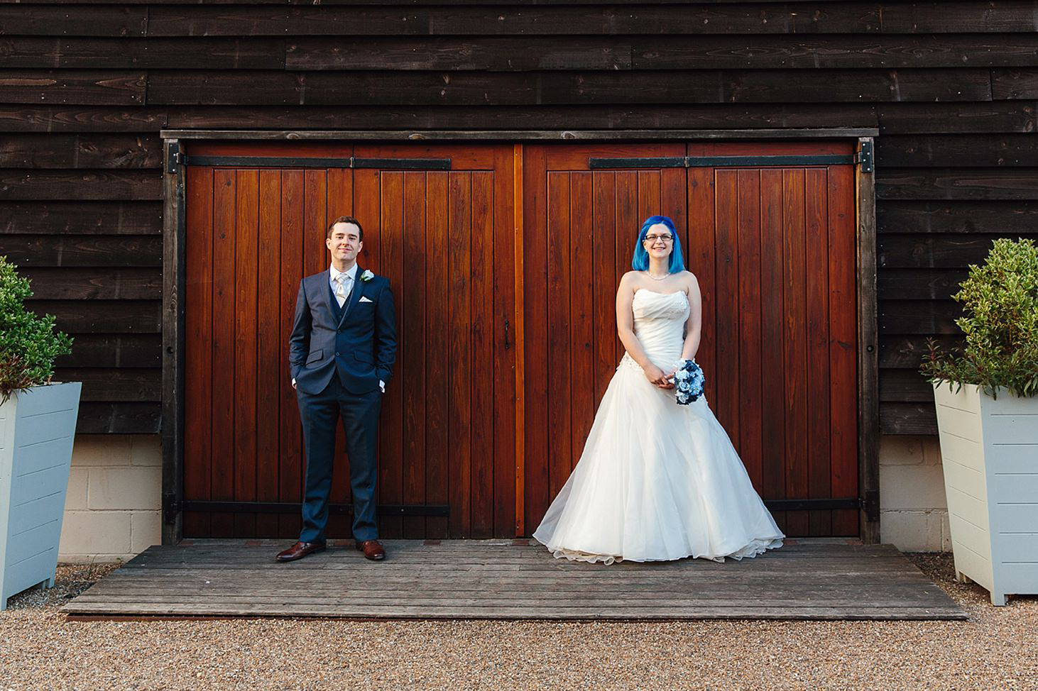 gate street barn wedding photography bride and groom infant of barn doors
