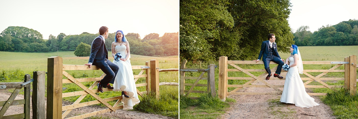 gate street barn wedding photography bride and groom sitting on gate