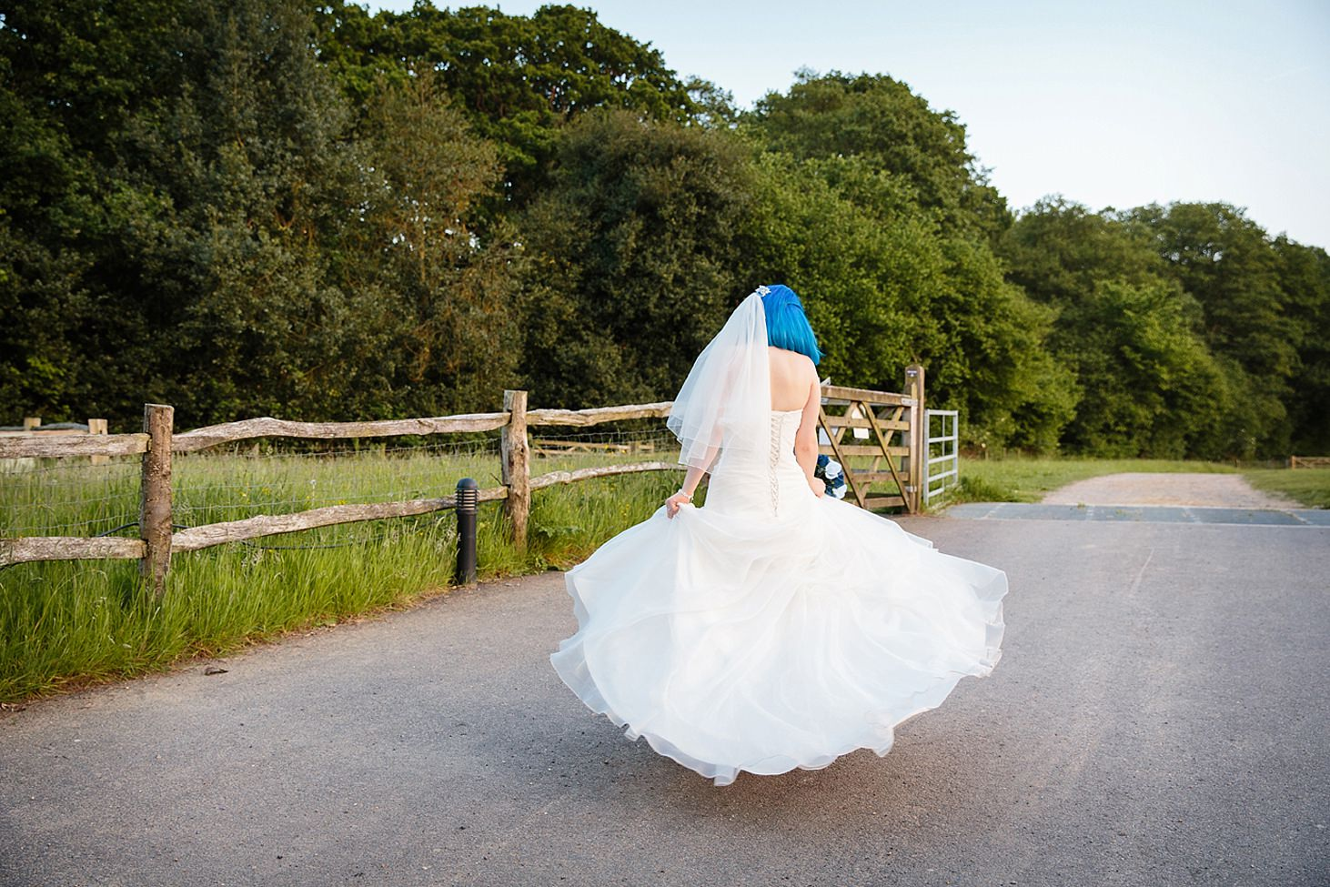 gate street barn wedding photography bride twirling skirt