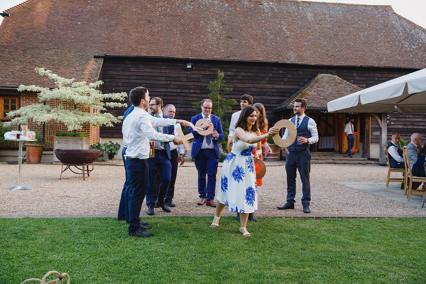 gate street barn wedding photography wedding guest throwing game
