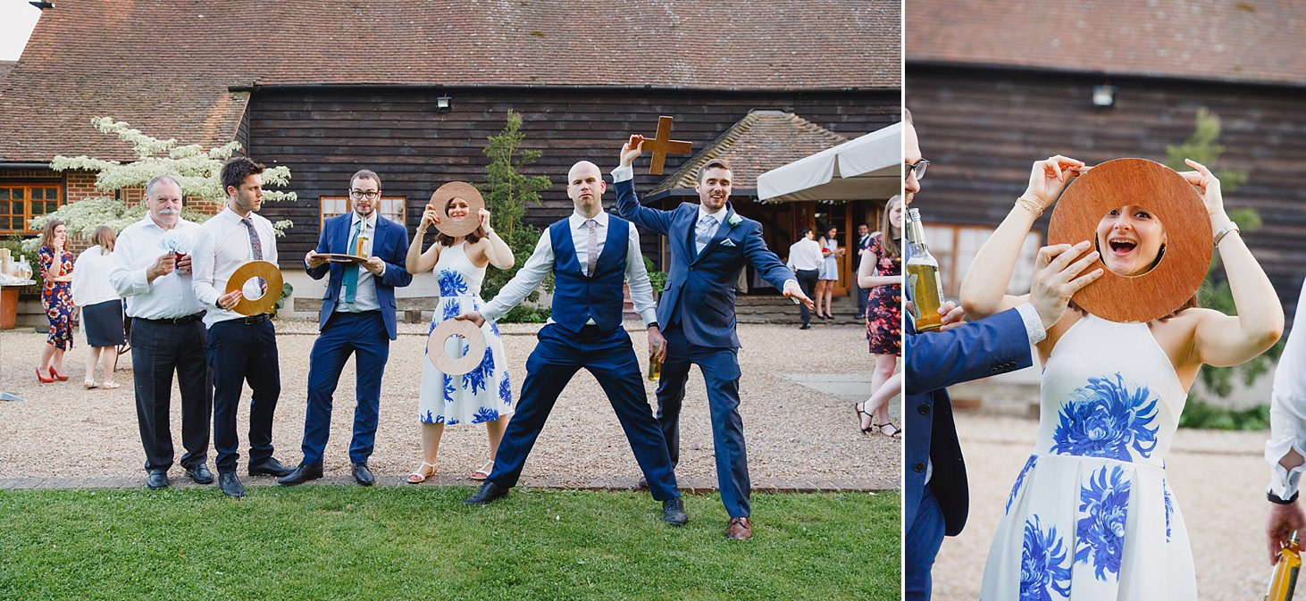 gate street barn wedding photography wedding guests posing with games