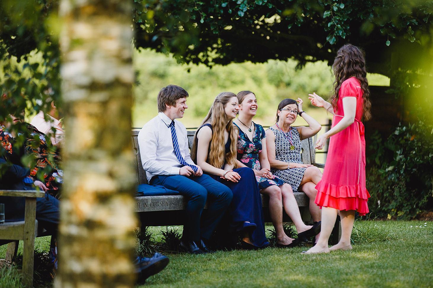 gate street barn wedding photography wedding guests talking