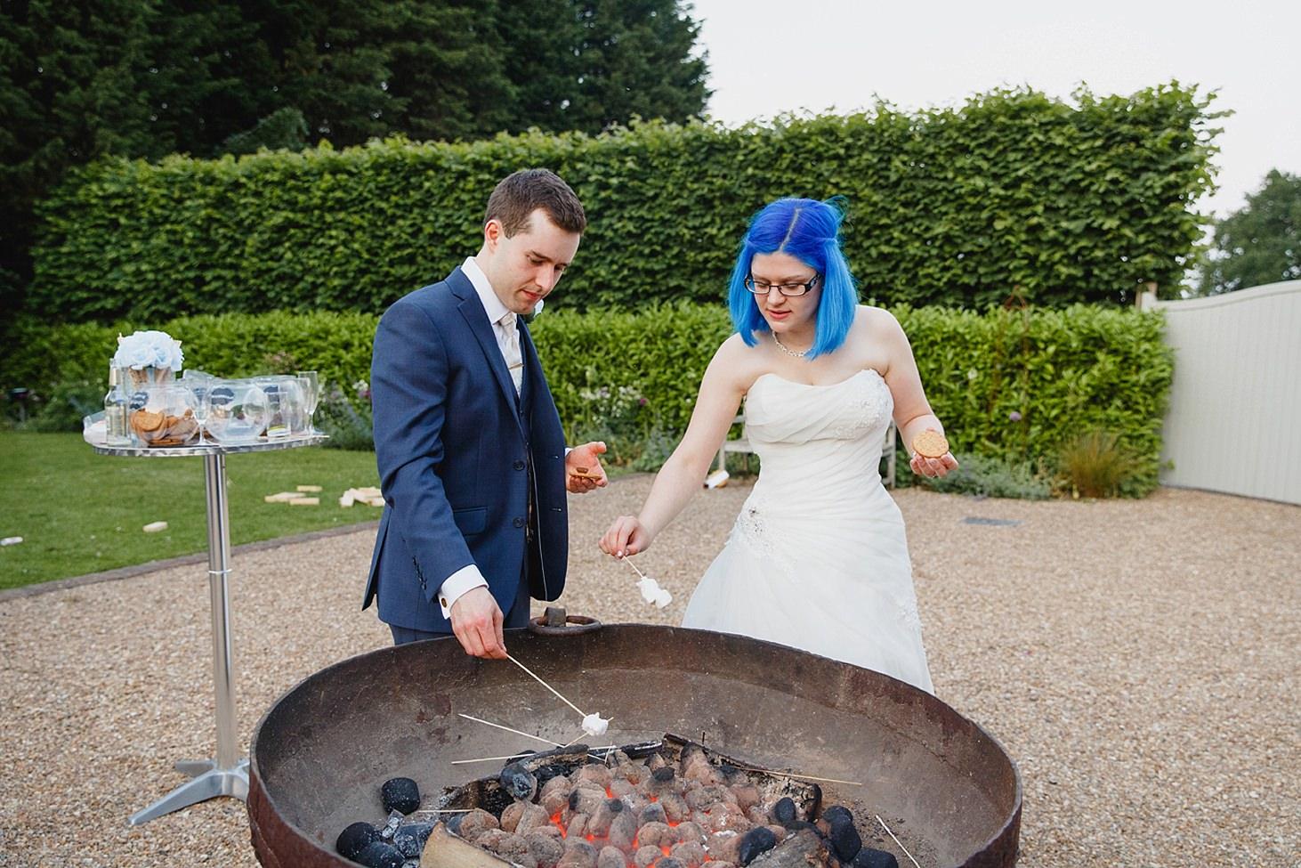 gate street barn wedding photography making smores