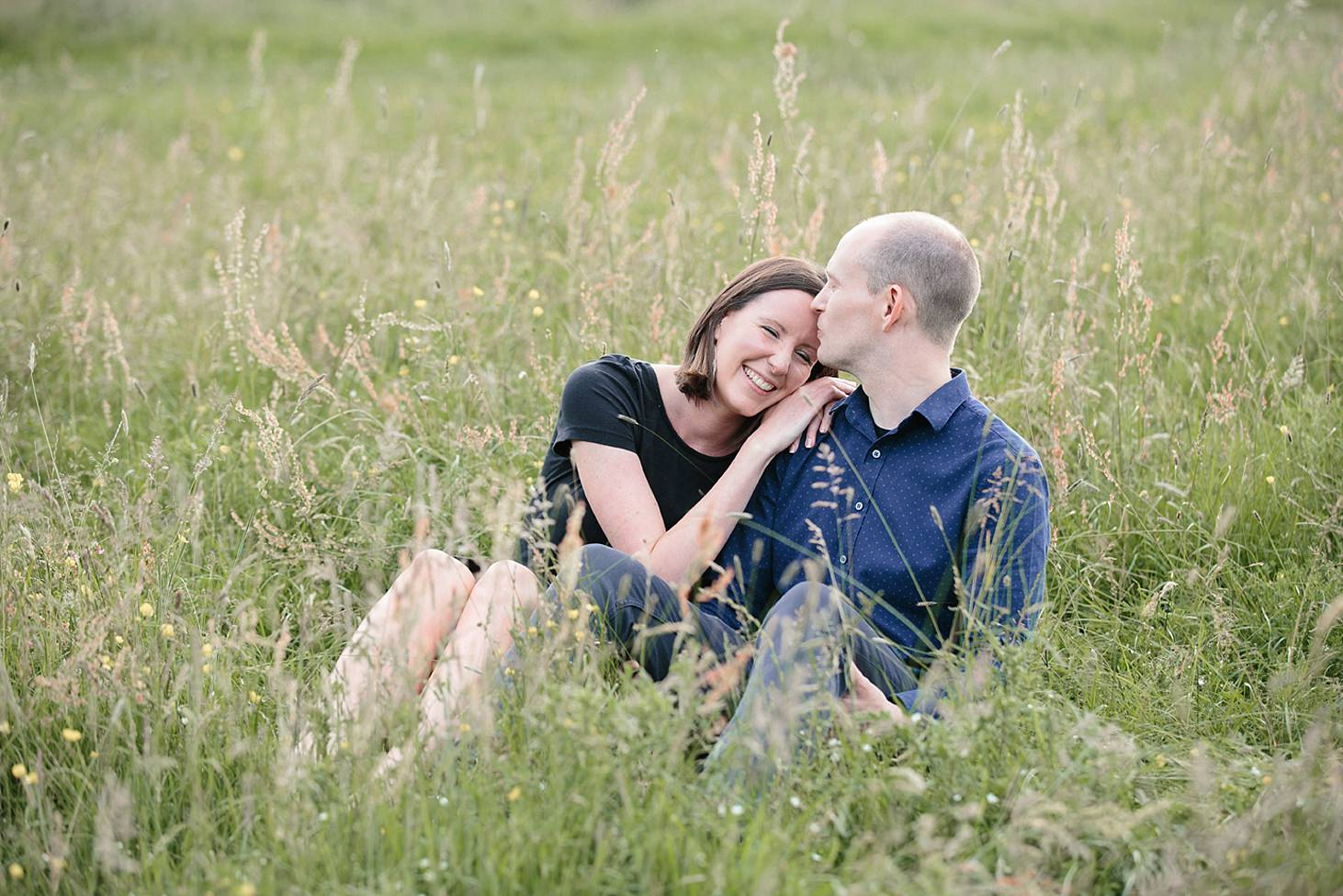 trent park engagement shoot couple in the grass